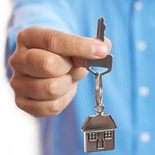 Hand holding out a house-key
